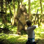 Lad shooting 2D bear